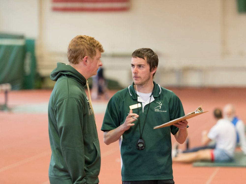 Student trainer talking to a client