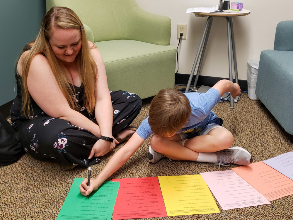 counseling student works with elementary student